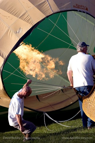 Two guys filling a hot air balloon