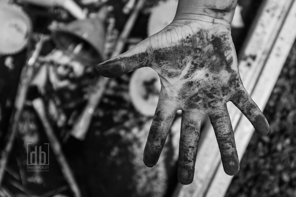 Child's hand covered in chocolate powder by David Bickley Photography