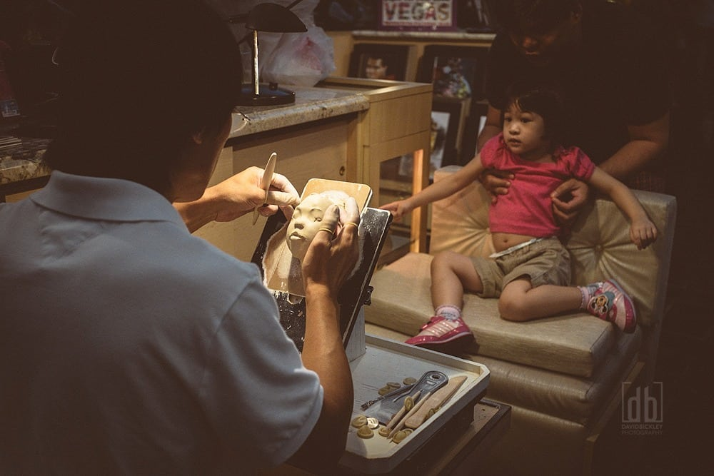 Chinese Sculptor sculpts childs face in clay, by David Bickley Photography