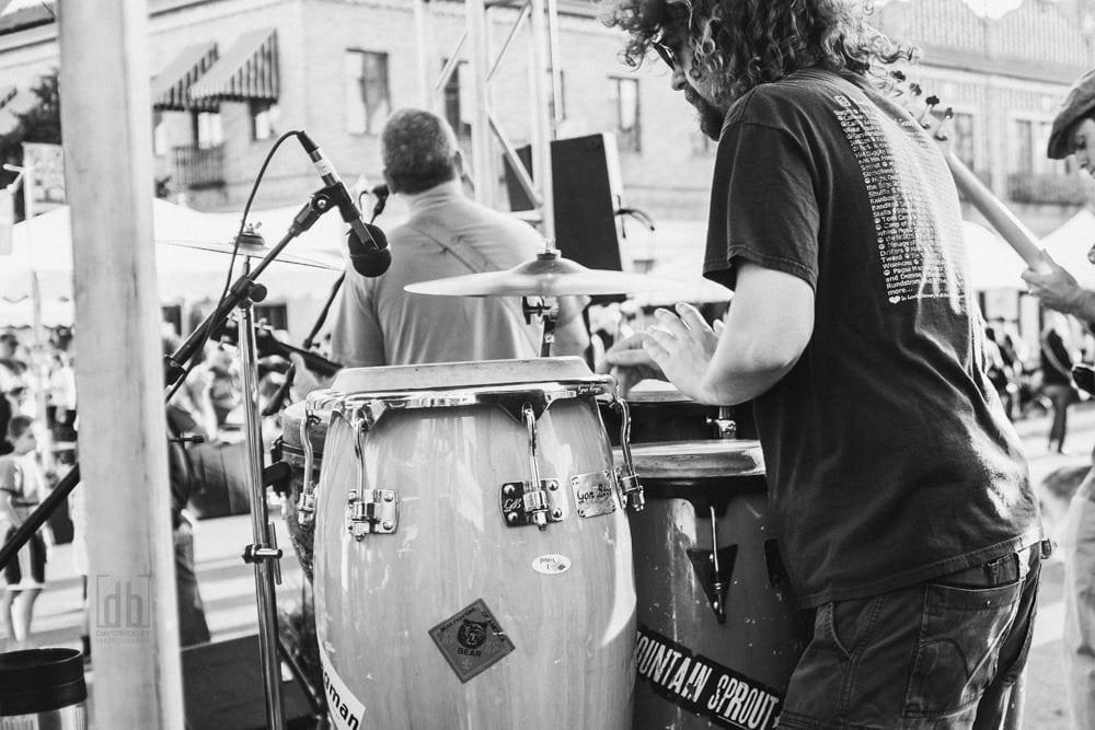 Musician playing drums by David Bickley Photography